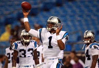 CHARLOTTE, NC - AUGUST 13:  Cam Newton #1 of the Carolina Panthers warms up before their preseason game against the New York Giants at Bank of America Stadium on August 13, 2011 in Charlotte, North Carolina.  (Photo by Streeter Lecka/Getty Images)
