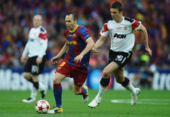 Iniesta cuts past Michael Carrick in the 2011 Champions League final.