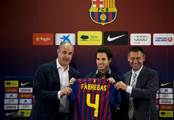Cesc Fabregas is given the Barcelona number 4 shirt