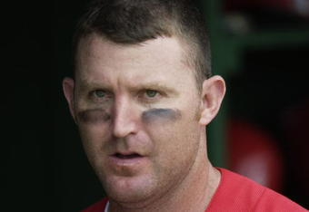 CLEARWATER, FL - FEBRUARY 28:  Jim Thome #25 of the Philadelphia Phillies looks on from the dugout against the New York Yankees in a spring training game on February 28, 2003 at Jack Russell Stadium in Clearwater, Florida. (Photo by Ezra Shaw/Getty Images