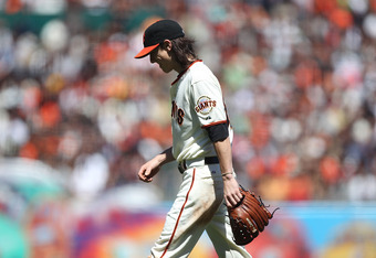 Tim Lincecum walks off the mound after just 3.2 innings, eventually losing to the first-place Padres, 8-2 on August 15, 2010.