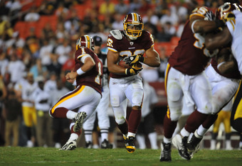 LANDOVER, MD - AUGUST 12:  Roy Helu #26 of the Washington Redskins runs the ball against the Pittsburgh Steelers  at FedExField on August 12, 2011 in Landover, Maryland. The Redskins defeated the Steelers 16-7. (Photo by Larry French/Getty Images)