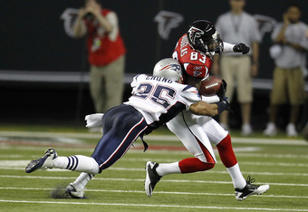 ATLANTA - AUGUST 19:  Wide receiver Harry Douglas #83 of the Atlanta Falcons is tackled by safety Patrick Chung #25 of the New England Patriots during the preseason game at the Georgia Dome on August 19, 2010 in Atlanta, Georgia.  (Photo by Mike Zarrilli/