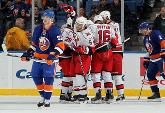 UNIONDALE, NY - FEBRUARY 06:  The Carolina Hurricanes celebrate their second goal scored by Patrick Dwyer #39 as Blake Comeau #57 and Mark Streit #2 of the New York Islanders look on on February 6, 2010 at Nassau Coliseum in Uniondale, New York.  (Photo b