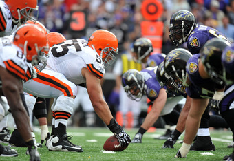 BALTIMORE - SEPTEMBER 26:  Alex Mack #55 of the Cleveland Browns snaps the ball against the Baltimore Ravens  at M&T Bank Stadium on September 26, 2010 in Baltimore, Maryland. The Ravens defeated the Browns 24-17. (Photo by Larry French/Getty Images)
