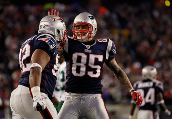 FOXBORO, MA - JANUARY 16:  Aaron Hernandez #85 and Alge Crumpler #82 of the New England Patriots celebrate Crumpler's catch during their 2011 AFC divisional playoff game at Gillette Stadium on January 16, 2011 in Foxboro, Massachusetts.  (Photo by Jim Rog