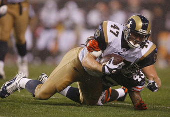 CLEVELAND - AUGUST 21:  Billy Bajema #47 of the St. Louis Rams dives for yardage as he is hit by T.J. Ward #43 of the Cleveland Browns at Cleveland Browns Stadium on August 21, 2010 in Cleveland, Ohio.  (Photo by Matt Sullivan/Getty Images)