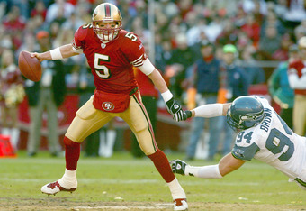 SAN FRANCISCO - DECEMBER 27:  Quarterback Jeff Garcia #5 of the San Francisco 49ers scambles against Chad Brown #94 of the Seattle Seahawks during an NFL game on December 27, 2003 at Candlestick Park in San Francisco, California.  (Photo by Jed Jacobsohn/