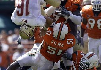 Miami's Jon Vilma earns his play by flipping over FSU quarterback Chris Rix.