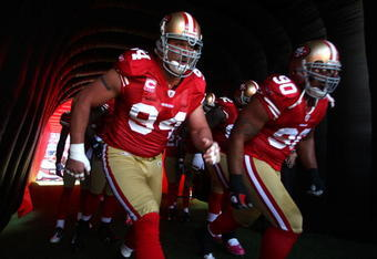 SAN FRANCISCO - OCTOBER 04:  Justin Smith #94 and Isaac Sopoaga #90 of the San Francisco 49ers enter the field against the St. Louis Rams during an NFL game on October 4, 2009 at Candlestick Park in San Francisco, California.  (Photo by Jed Jacobsohn/Gett