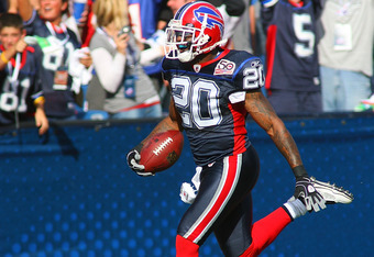 ORCHARD PARK, NY - SEPTEMBER 20:  Donte Whitner #20  of the Buffalo Bills returns an intercepted pass 76  yards for a touchdown against the Tampa Bay Buccaneers at Ralph Wilson Stadium on September 20, 2009 in Orchard Park, New York.  (Photo by Rick Stewa