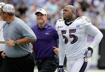 BALTIMORE, MD - AUGUST 06:  Head coach John Harbaugh (C) jogs down the field with Terrell Suggs #55 of the Baltimore Ravens during training camp at M&T Bank Stadium on August 6, 2011 in Baltimore, Maryland.  (Photo by Rob Carr/Getty Images)