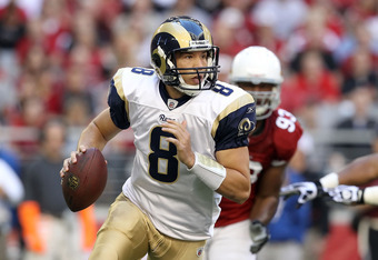 GLENDALE, AZ - DECEMBER 05:  Quarterback Sam Bradford #8 of the St. Louis Rams scrambles with the football during the NFL game against the Arizona Cardinals at the University of Phoenix Stadium on December 5, 2010 in Glendale, Arizona.  (Photo by Christia