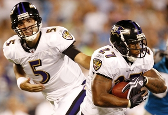 CHARLOTTE, NC - AUGUST 29: Running back Ray Rice #27 of the Baltimore Ravens get a hand off from quarterback Joe Flacco #5 during their game against the Carolina Panthers at Bank of America Stadium on August 29, 2009 in Charlotte, North Carolina. (Photo by Streeter Lecka/Getty Images)