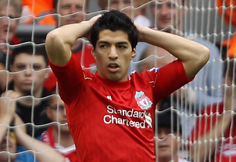 LIVERPOOL, ENGLAND - AUGUST 13:  Luis Suarez of Liverpool reacts after he misses a penalty kick during the Barclays Premier League match between Liverpool and Sunderland at Anfield on August 13, 2011 in Liverpool, England.  (Photo by Clive Brunskill/Getty Images)