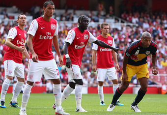 LONDON, ENGLAND - JULY 31:  (L-R) Thomas Vermaelen, Marouane Chamakh, Bacary Sagna and Aaron Ramsey of Arsenal and Thierry Henry of New York Red Bulls during the Emirates Cup match between Arsenal and New York Red Bulls at the Emirates Stadium on July 31, 2011 in London, England.  (Photo by Richard Heathcote/Getty Images)