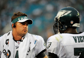 JACKSONVILLE, FL - SEPTEMBER 26:  Quarterbacks Kevin Kolb #4 and Michael Vick #7 of the Philadelphia Eagles talk on the sidelines during a time-out against the Jacksonville Jaguars at EverBank Field on September 26, 2010 in Jacksonville, Florida. The Eagles defeated the Jaguars 28-3.  (Photo by Doug Benc/Getty Images)