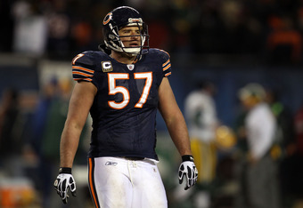 CHICAGO, IL - JANUARY 23:  Olin Kreutz #57 of the Chicago Bears looks on late in the fourth quarter against the Green Bay Packers in the NFC Championship Game at Soldier Field on January 23, 2011 in Chicago, Illinois.  (Photo by Jonathan Daniel/Getty Images)