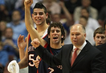 ANAHEIM, CA - DECEMBER 8: Carlin Hughes #3 and Omar Samhan #50 of the Saint Mary's College Gaels celebrate a 69-64 win along with Head Coach Randy Bennett over the San Diego State Aztecs during the second half for the John Wooden Classic at the Honda Center December 8, 2007 in Anaheim, California.  (Photo by Harry How/Getty Images)