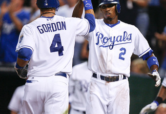 KANSAS CITY, MO - AUGUST 18:  Alex Gordon #4 of the Kansas City Royals is congratulated by Alcides Escobar #2 after hitting a two-run home run in the third inning during a game against the Boston Red Sox at Kauffman Stadium on August 18, 2011 in Kansas City, Missouri. (Photo by Ed Zurga/Getty Images)