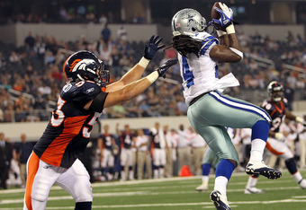ARLINGTON, TX - AUGUST 11: Dwayne Harris #14 of the Dallas Cowboys makes a touchdown pass reception against Mike Mohamed #53 of the Denver Broncos in the fourth quarter at Cowboys Stadium on August 11, 2011 in Arlington, Texas.  (Photo by Ronald Martinez/Getty Images)