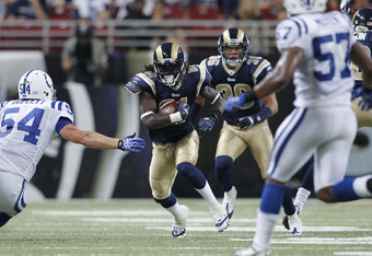 ST. LOUIS, MO - AUGUST 13: Mardy Gilyard #81 of the St. Louis Rams looks for room to run on a punt return against the Indianapolis Colts during the NFL preseason game at Edward Jones Dome on August 13, 2011 in St. Louis, Missouri. The Rams defeated the Colts 33-10. (Photo by Joe Robbins/Getty Images)