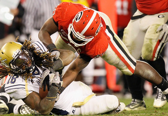 ATHENS, GA - NOVEMBER 27:  Darryl Gamble #50 of the Georgia Bulldogs attempts to strip the ball from Anthony Allen #18 of the Georgia Tech Yellow Jackets at Sanford Stadium on November 27, 2010 in Athens, Georgia.  (Photo by Kevin C. Cox/Getty Images)