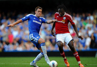 LONDON, ENGLAND - AUGUST 20:  John Terry of Chelsea and Somen Tchoyi of West Brom compete for the ball during the Barclays Premier League match between Chelsea and West Bromwich Albion at Stamford Bridge on August 20, 2011 in London, England.  (Photo by Laurence Griffiths/Getty Images)