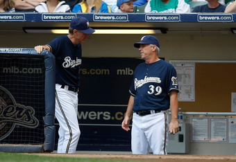 MILWAUKEE, WI - AUGUST 14: Ron Roenicke #10 of the Milwaukee Brewers talks with Rick Kranitz #39 against the Pittsburgh Pirates at Miller Park on August 14, 2011 in Milwaukee, Wisconsin. (Photo by Scott Boehm/Getty Images)