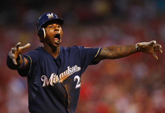 ST. LOUIS, MO - AUGUST 9: Nyjer Morgan #2 of the Milwaukee Brewers celebrates hitting a triple against the St. Louis Cardinals at Busch Stadium on August 9, 2011 in St. Louis, Missouri.  (Photo by Dilip Vishwanat/Getty Images)