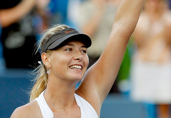 MASON, OH - AUGUST 21:  Maria Sharapova of Russia celebrates her win over Jelena Jankovic of Serbia during the final of the Western & Southern Open at the Lindner Family Tennis Center on August 21, 2011 in Mason, Ohio.  (Photo by Matthew Stockman/Getty Images)