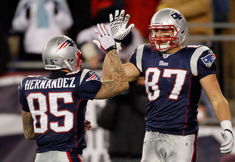 FOXBORO, MA - DECEMBER 06:  (L-R) Aaron Hernandez #85 and Rob Gronkowski #87 of the New England Patriots celebrate a play against the New York Jets at Gillette Stadium on December 6, 2010 in Foxboro, Massachusetts. The Patriots won 45-3. (Photo by Jim Rogash/Getty Images)