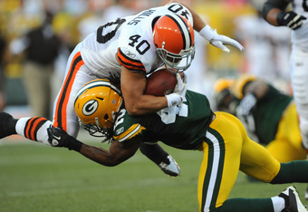GREEN BAY - AUGUST 14: Peyton Hillis #40 of the Cleveland Browns is tackled by Morgan Burnett #42 of the Green Bay Packers during the NFL preseason game at Lambeau Field August 14, 2010 in Green Bay, Wisconsin.  (Photo by Tom Dahlin/Getty Images)