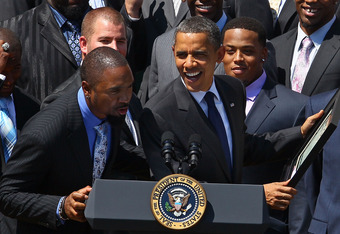 WASHINGTON, DC - AUGUST 12:  U.S. President Barack Obama (C) jokes with Charles Woodson (L), after recieving a ownership certificate during a reception for the National Football League Super Bowl XLV champions on the south lawn of the White House August 12, 2011 in Washington, DC. The Packers, lead by head coach Mike McCarthy, finished the 2010 season with a winning record of 10-6, and defeated the Pittsburgh Steelers 31-25 to take the championship.  (Photo by Mark Wilson/Getty Images)