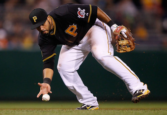 PITTSBURGH - AUGUST 05: Pedro Alvarez #24 of the Pittsburgh Pirates bare hands a ground ball against the San Diego Padres during the game on August 5, 2011 at PNC Park in Pittsburgh, Pennsylvania.  (Photo by Jared Wickerham/Getty Images)