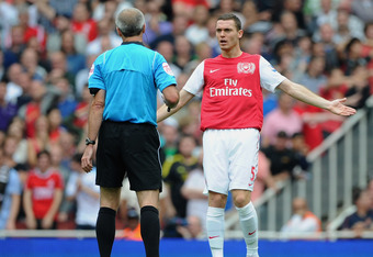 LONDON, ENGLAND - AUGUST 20:  Thomas Vermaelen of Arsenal remonstrates with referee Martin Atkinson during the Barclays Premier League match between Arsenal and Liverpool at the Emirates Stadium on August 20, 2011 in London, England.  (Photo by Michael Regan/Getty Images)