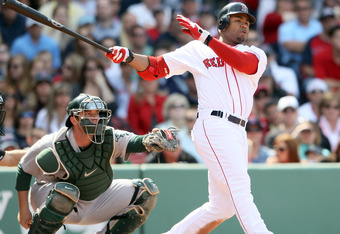 BOSTON, MA - JUNE 04:  Carl Crawford hits a 2 RBI double in the eighth inning on June 4, 2011 vs the Oakland A's at Fenway Park. (Photo by Elsa/Getty Images)