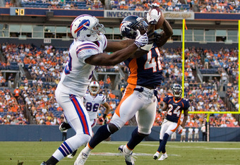 DENVER, CO - AUGUST 20:  Cornerback Cassius Vaughn #41 of the Denver Broncos breaks up a pass attempt for wide receiver Donald Jones #19 of the Buffalo Bills during the first quarter at Sports Authority Field at Mile High on August 20, 2011 in Denver, Colorado. (Photo by Justin Edmonds/Getty Images)