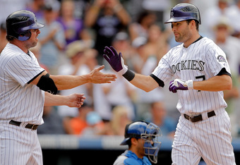 DENVER, CO - AUGUST 21:  Seth Smith #7 of the Colorado Rockies is greeted at home plate by Jason Giambi #23 after hitting a two run go-ahead home run during the seventh inning against the Los Angeles Dodgers at Coors Field on August 21, 2011 in Denver, Colorado.  The Rockies defeated the Dodgers 5-3. (Photo by Justin Edmonds/Getty Images)