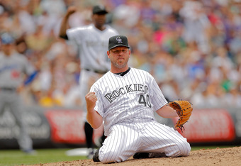 DENVER, CO - AUGUST 21:  Kevin Millwood #40 and Chris Nelson #10 of the Colorado Rockies react after Millwood started a double play against the Los Angeles Dodgers at Coors Field on August 21, 2011 in Denver, Colorado.  The Rockies defeated the Dodgers 5-3. (Photo by Justin Edmonds/Getty Images)