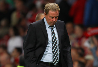 MANCHESTER, ENGLAND - AUGUST 22:  Tottenham Hotspur manager Harry Redknapp looks dejected after defeat in the Barclays Premier League match between Manchester United and Tottenham Hotspur at Old Trafford on August 22, 2011 in Manchester, England.  (Photo by Alex Livesey/Getty Images)