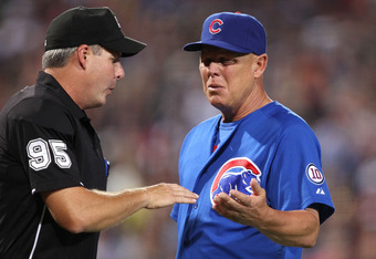 ATLANTA, GA - AUGUST 12:  Manager Mike Quade #8 of the Chicago Cubs argues with home plate umpire Tim Timmons #95 after pitcher Carlos Zambrano is ejected during the game against the Atlanta Braves at Turner Field on August 12, 2011 in Atlanta, Georgia.  (Photo by Mike Zarrilli/Getty Images)