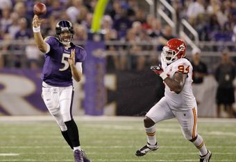 BALTIMORE, MD - AUGUST 19:  Quarterback Joe Flacco #5 of the Baltimore Ravens gets off a pass while being chased by Tyson Jackson #94 of the Kansas City Chiefs during the first half of a preseason game at M&T Bank Stadium on August 19, 2011 in Baltimore, Maryland.  (Photo by Rob Carr/Getty Images)