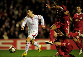 LIVERPOOL, ENGLAND - MARCH 18:  Eden Hazard of Lille breaks clear of the challenge of Glen Johnson of Liverpool during the UEFA Europa League Round of 16, second leg match at Anfield on March 18, 2010 in Liverpool, England.  (Photo by Shaun Botterill/Getty Images)