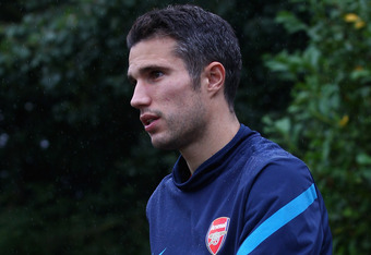ST ALBANS, ENGLAND - AUGUST 23: Robin Van Persie of Arsenal arrives for a training session ahead of their UEFA Champions League Qualifying second leg match against Udinese at London Colney on August 23, 2011 in St Albans, England. (Photo by Julian Finney/Getty Images)