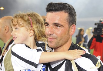 UDINE, ITALY - MAY 22:  Antonio Di Natale of Udinese celebrates qualification for the UEFA Champions League qualification with his children after the Serie A match between Udinese Calcio and AC Milan  at Stadio Friuli on May 22, 2011 in Udine, Italy.  (Photo by Dino Panato/Getty Images)