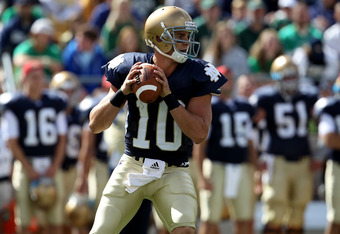 SOUTH BEND, IN - SEPTEMBER 04: Dayne Crist #10 of the Notre Dame Fighting Irish looks for a receiver against the Purdue Boilermakers at Notre Dame Stadium on September 4, 2010 in South Bend, Indiana. Notre Dame defeated Purdue 23-12. (Photo by Jonathan Daniel/Getty Images)