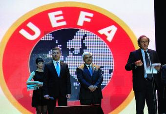 BAKU, AZERBAIJAN - JUNE 06:  UEFA president Michel Platini speaks as FIFA president Sepp Blatter (R) looks on during a dinner celebration to mark 100 years of Football in Azerbaijan on June 6, 2011 in Baku, Azerbaijan.  (Photo by Stu Forster/Getty Images)