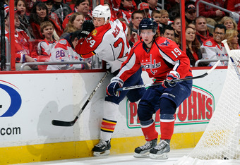 WASHINGTON - JANUARY 08:  Nicklas Backstrom #19 of the Washington Capitals checks Bryan McCabe #24 of the Florida Panthers at the Verizon Center on January 8, 2011 in Washington, DC.  (Photo by Greg Fiume/Getty Images)