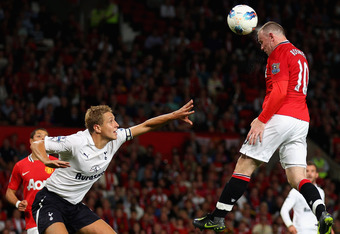 MANCHESTER, ENGLAND - AUGUST 22:  Wayne Rooney of Manchester United scores his side's third goal during the Barclays Premier League match between Manchester United and Tottenham Hotspur at Old Trafford on August 22, 2011 in Manchester, England.  (Photo by Alex Livesey/Getty Images)